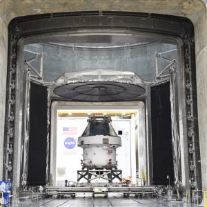 Orion spacecraft being moved into test chamber.